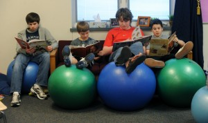 people reading on yoga ball