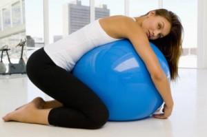 woman hug yoga ball