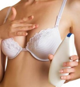 woman using breast cream