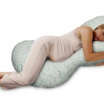 pregnant woman sleeping using pregnancy pillow