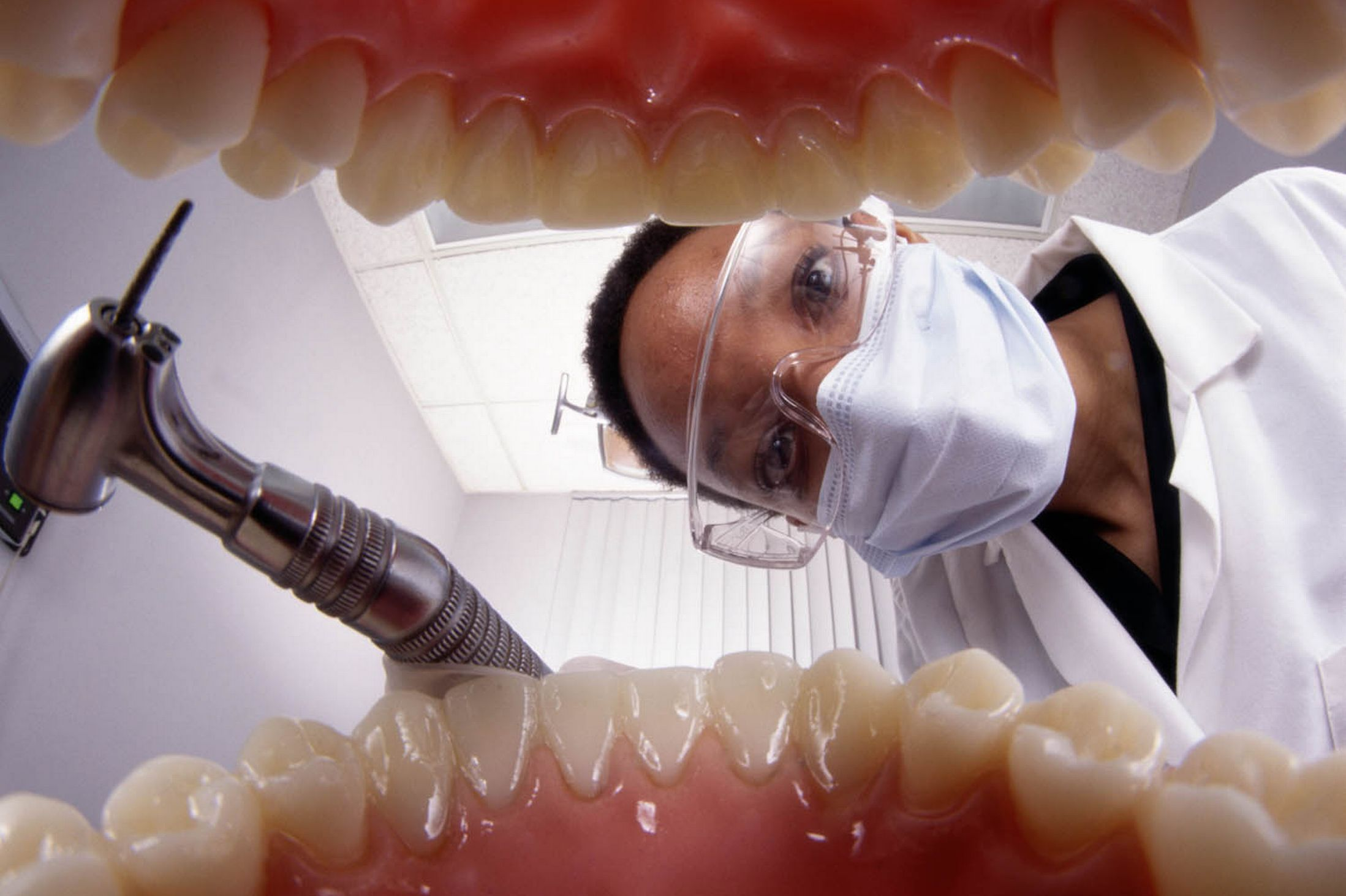 dentist looking inside mouth